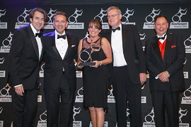 Dwain McDonald (second left) and HR Manager Sharon Hughes collect the Training Award