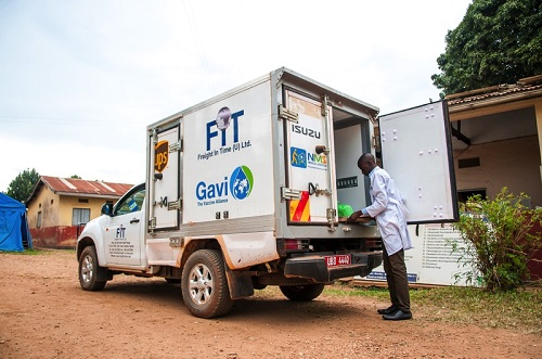 FIT staff offloading vaccines at Buwambo Health Center, Uganda