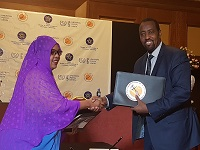 Bishar Hussein with Ethiopian minister Efrah Ali Musa